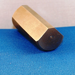 Tapered locking pin surface broached on three angular surfaces using a high speed broaching machine.